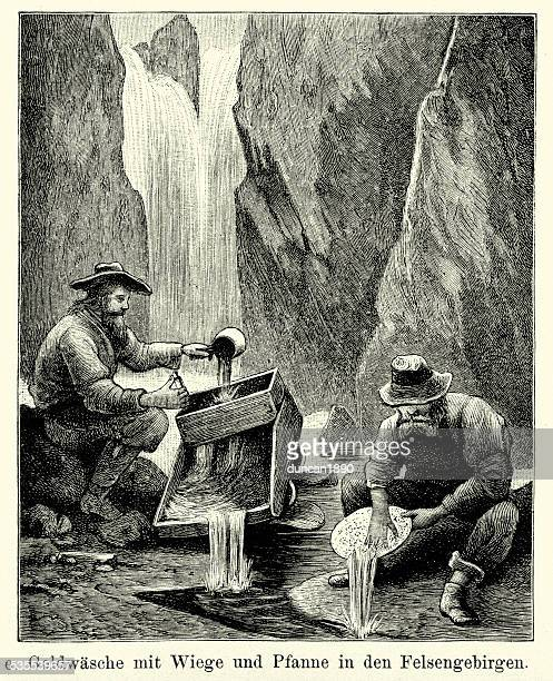 19th century north america -  gold miners in rocky mountains - gold rush stock illustrations