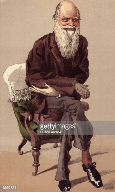 English naturalist Charles Darwin propped up on two cushions and in the wheeled chair he used for propelling himself round his work room Vanity Fair...
