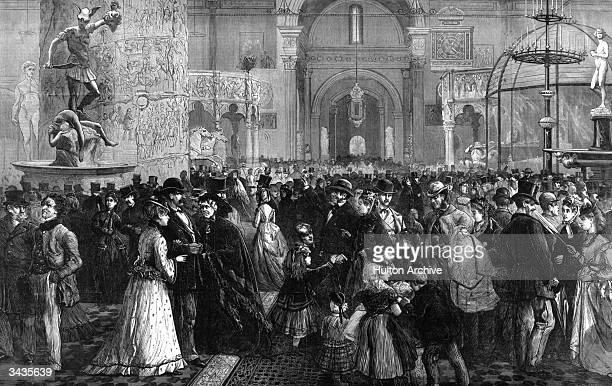 Whit Monday visitors crowd the antiquities room of the South Kensington Museum in London. Inspired by the Great Exhibition of 1851, the museum later...
