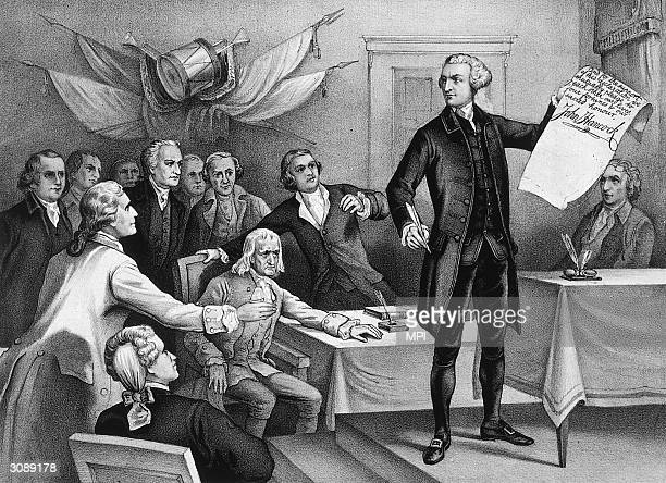 John Hancock , president of the Continental Congress is the first to put his signature to the Declaration of Independence, watched by fellow patriots...