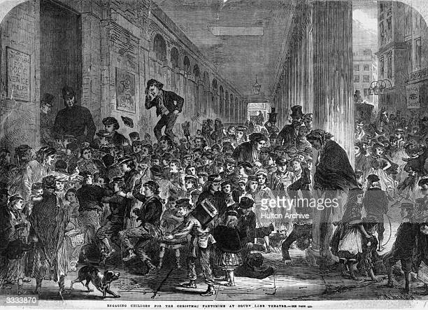 Engaging children for the Christmas pantomime at Drury Lane Theatre. Original Publication: Illustrated London News