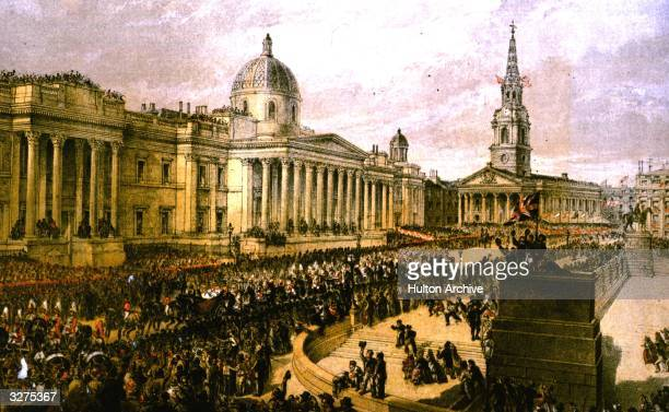 Crowds fill Trafalgar Square to watch the procession of Princess Alexandra of Denmark who has arrived in Britain to marry the future King Edward VII.