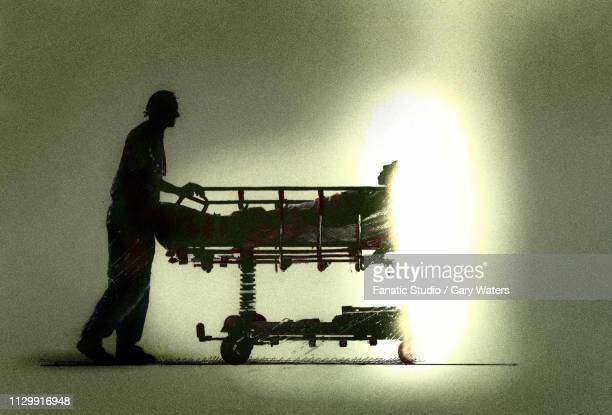 a concept image of a nurse pushing a patient into light symbolising assisted dying - euthanasia stock illustrations