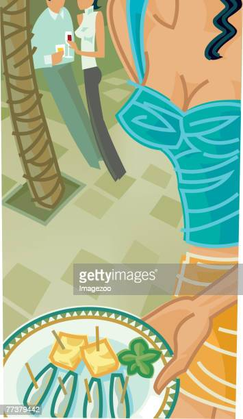 a woman serving hors'deurves