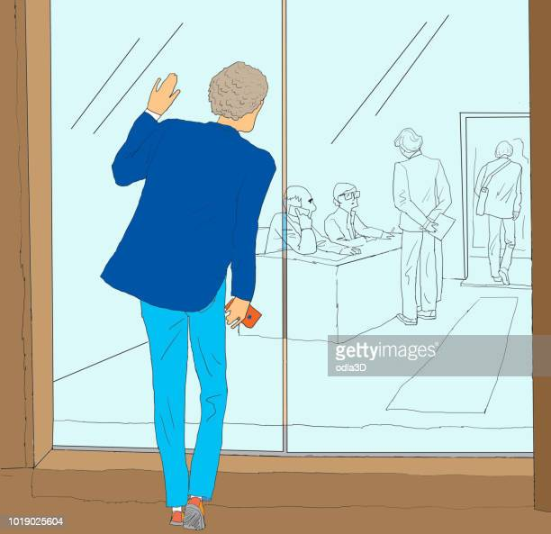 a young man entering the company to look for a job