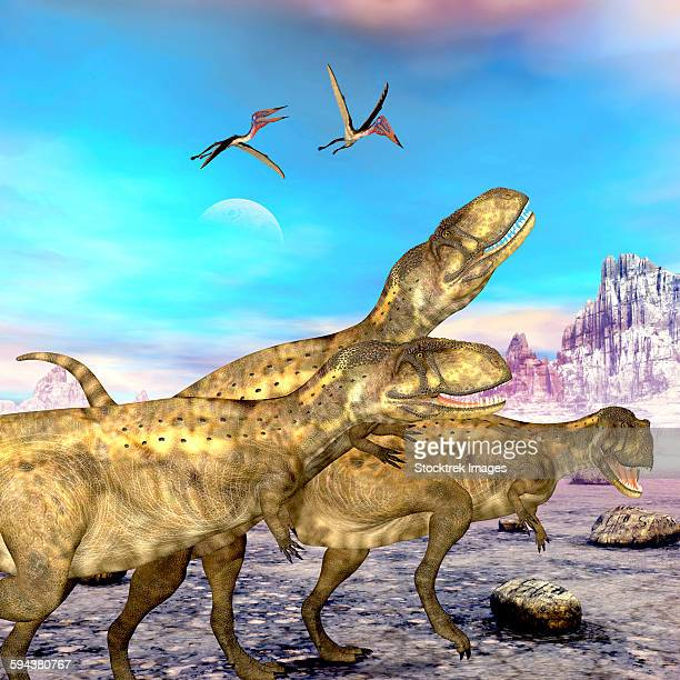 Abelisaurus theropod dinosaurs hunt for their next prey.