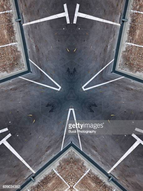 abstract image: kaleidoscopic image of empty parking lot in berlin, germany - road marking stock illustrations