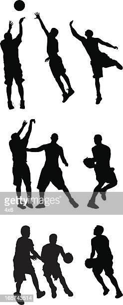 Active men playing basketball