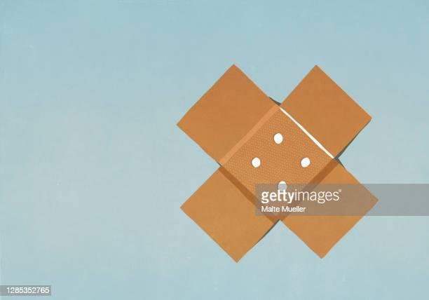 adhesive bandage on blue background - 包帯点のイラスト素材/クリップアート素材/マンガ素材/アイコン素材