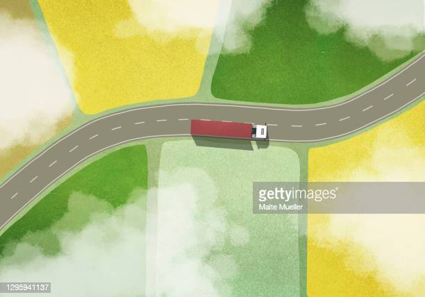 aerial view commercial truck driving through farm fields - road stock illustrations