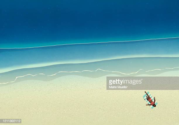 aerial view woman sunbathing on sunny ocean beach - horizontal stock illustrations
