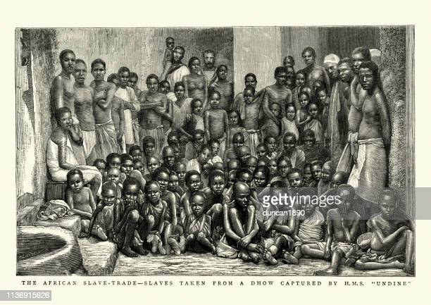 african slave trade, freed slave rescued by hms undine, 1884 - slavery stock illustrations