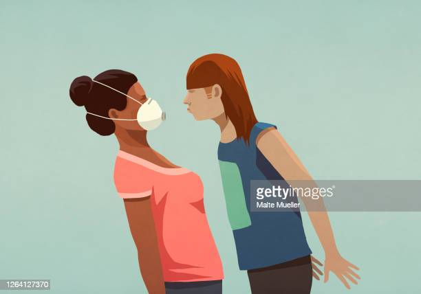 aggressive woman confronting woman in face mask - safety stock illustrations