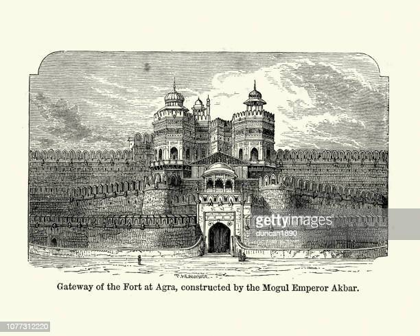 agra fort, constructed by mogul emperor akbar - mughal empire stock illustrations