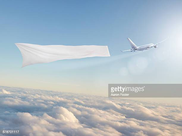 aircraft banner - spruchband stock-grafiken, -clipart, -cartoons und -symbole