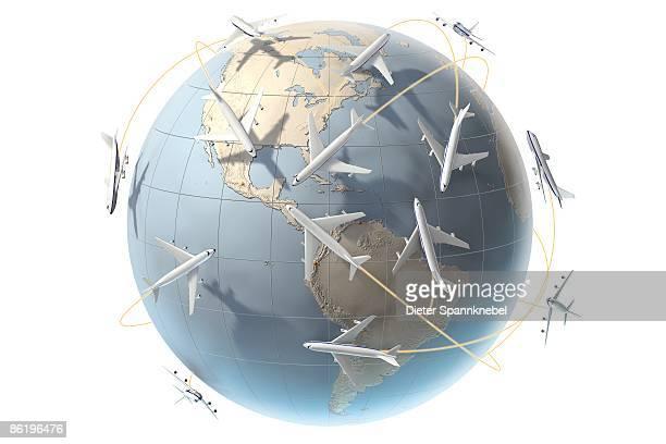 aircraft orbit a globe showing america - shiny stock illustrations