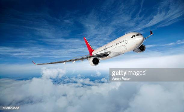 airplane in flight - journey stock illustrations