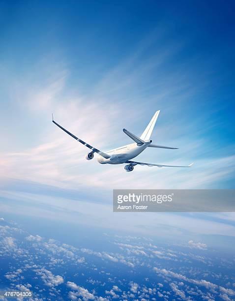 airplane in flight - australia day stock illustrations
