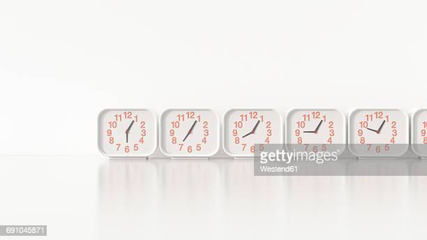 Alarm clocks in a row, 3d rendering