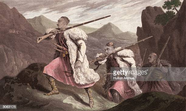 Albanian palikars in pursuit of an enemy wear longhaired sheepskin jackets and carry long barelled rifles as they climb through mountainous country