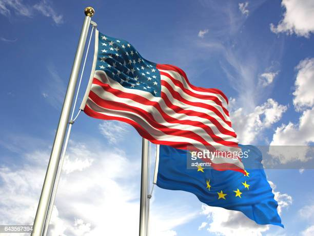 American and European Union flags waving against the sky