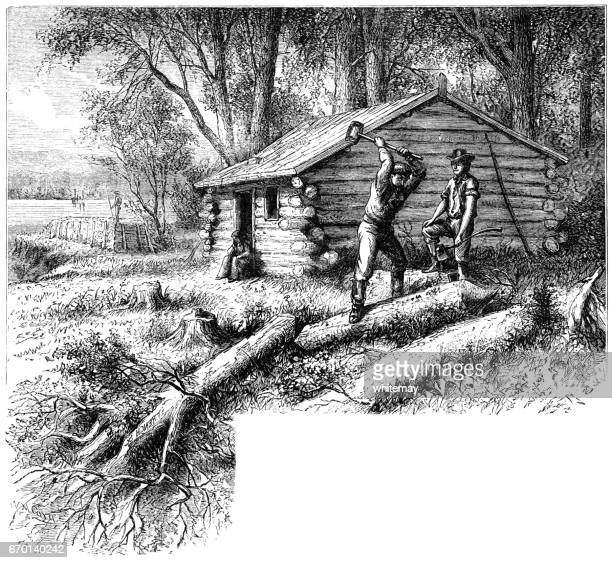 American pioneers building a new log cabin