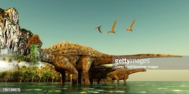 Ampelosaurus dinosaurs eating underwater vegetation.