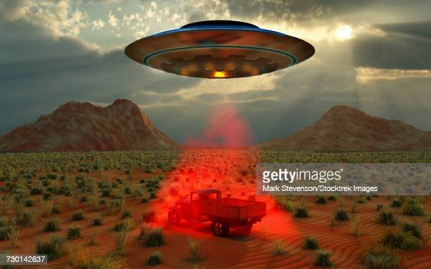 An alien UFO probing a 1930s style truck in a North American desert region of Earth.