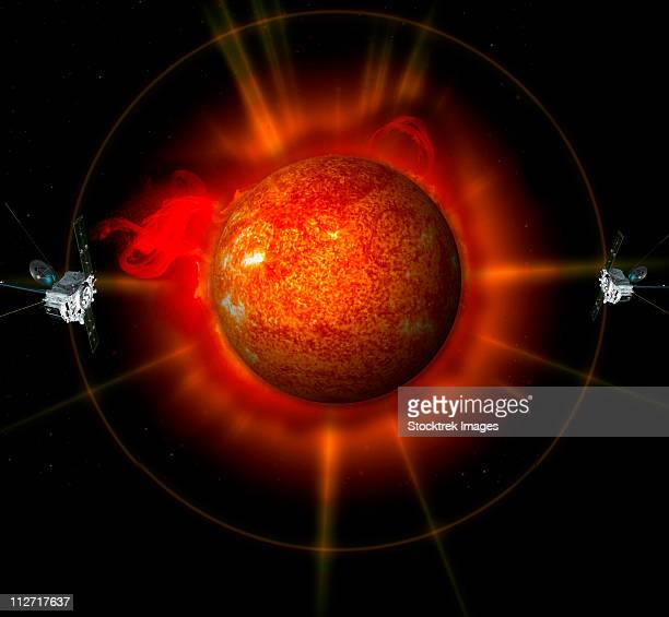 an artist's concept of the stereo spacecraft surrounding the sun. - solar flare stock illustrations, clip art, cartoons, & icons
