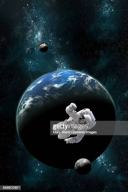 An astronaut floating in front of a water covered world with two moons.