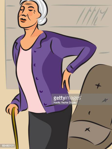 an elderly woman with a cane,   holding her back as she stands from her chair - human back stock illustrations, clip art, cartoons, & icons