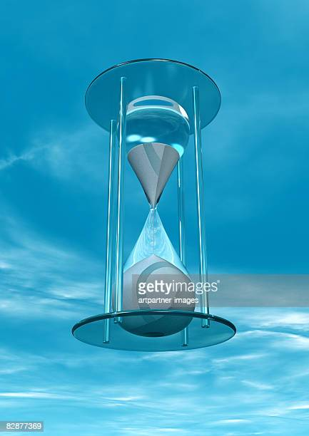 an hourglass in front of a blue sky - hourglass stock illustrations