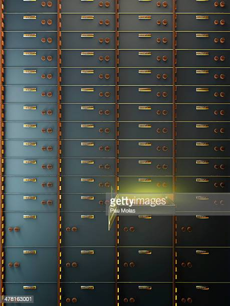 An open safety deposit box containing gold