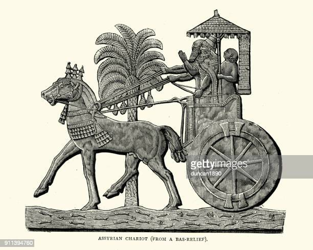 ancient assyrian chariot - relief carving stock illustrations