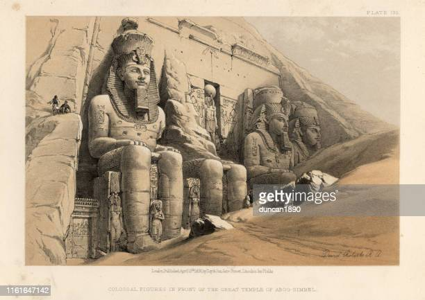 ancient colossal statues at great temple of abu simbel, egypt - egypt stock illustrations