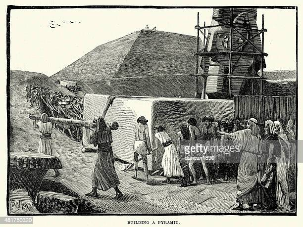 ancient egyptians building a pyramid - pyramid stock illustrations