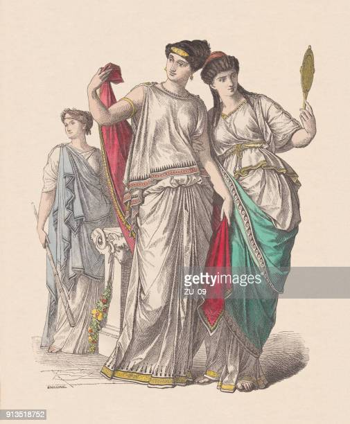 ancient greek fashion: priestess (left), and noble ladies, published c.1880 - ancient greece stock illustrations