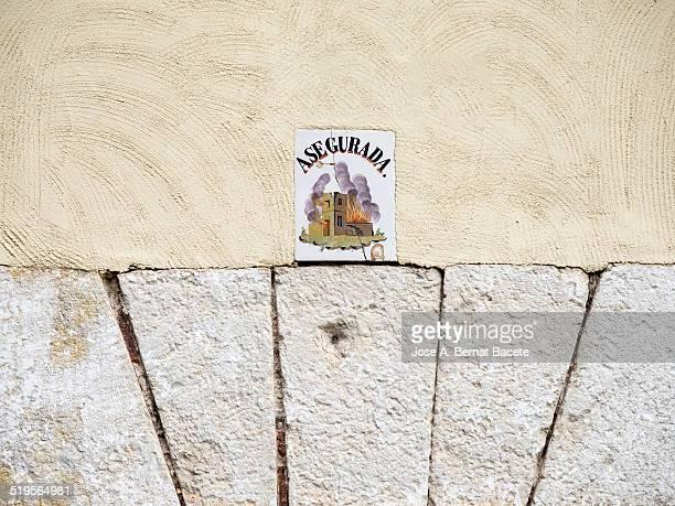 ancient sign of house assured against fires - comunidad autonoma de valencia stock illustrations