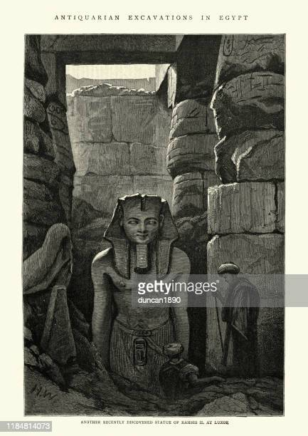 ancient statue of ramesses ii discovered at luxor, 19th century - thebes egypt stock illustrations