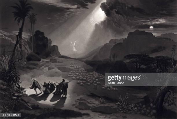 angel appearing before shepherds - prayer book stock illustrations