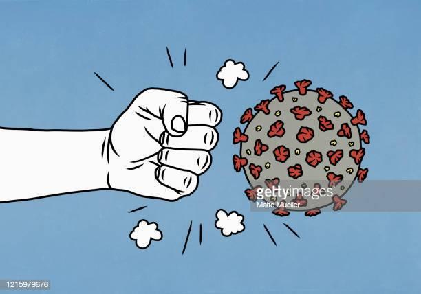 angry fist next to covid-19 coronavirus - pandemic stock illustrations