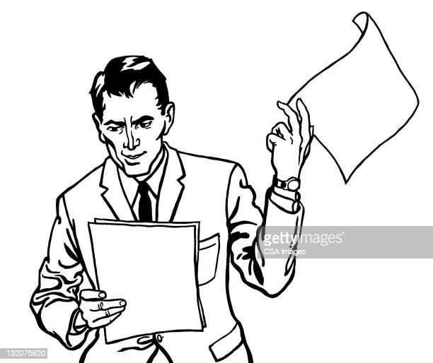 Annoyed Man Looking at Papers