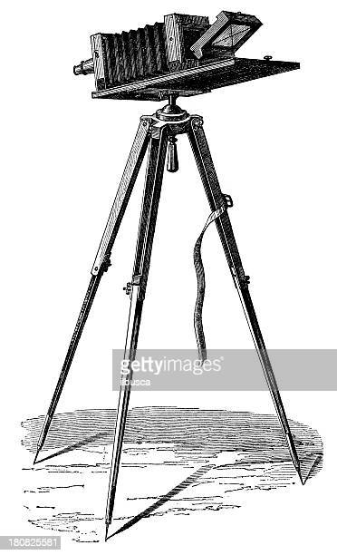 antique illustration of photography camera with tripod - camera tripod stock illustrations, clip art, cartoons, & icons