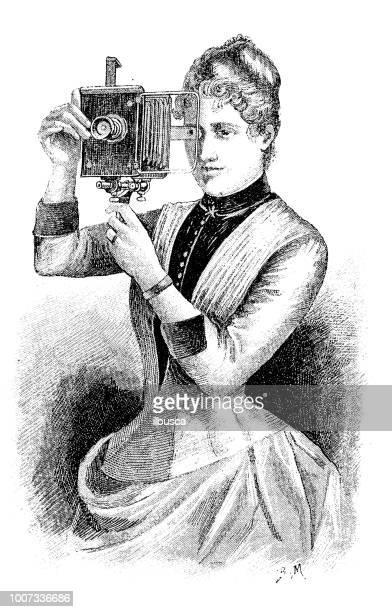 ilustrações de stock, clip art, desenhos animados e ícones de antique scientific engraving illustration: photographer - maquina fotografica antiga