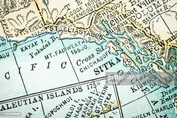antique usa map close-up detail: sitka, alaska - alaska us state stock illustrations