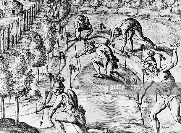 April 1562 Timucua tribesmen in Florida stick arrows with locks of hair attached to them along the public highways as a declaration of war to their...