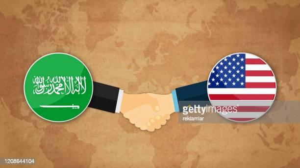 arabia and usa handshake, international friendship cartoon - diplomacy stock illustrations