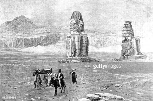 archaeologist at the memnon columns in egypt - thebes egypt stock illustrations