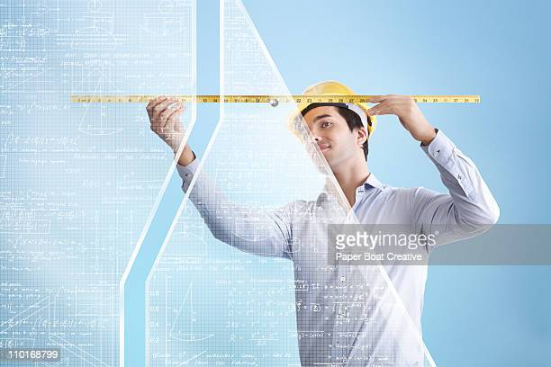 architect measuring a large glass wall - digital enhancement stock illustrations