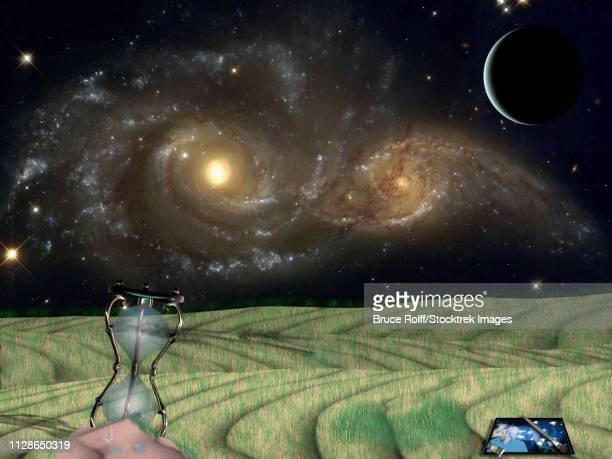 ilustraciones, imágenes clip art, dibujos animados e iconos de stock de art easel and hourglass on green field. vivid galaxies in the starry space - galaxiaespiral